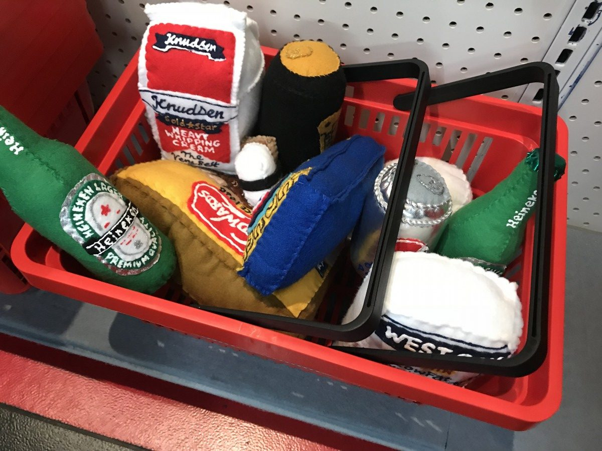 shopping basket with felt items in it